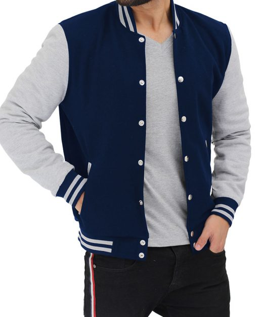 navy blue and gray varsity jacket